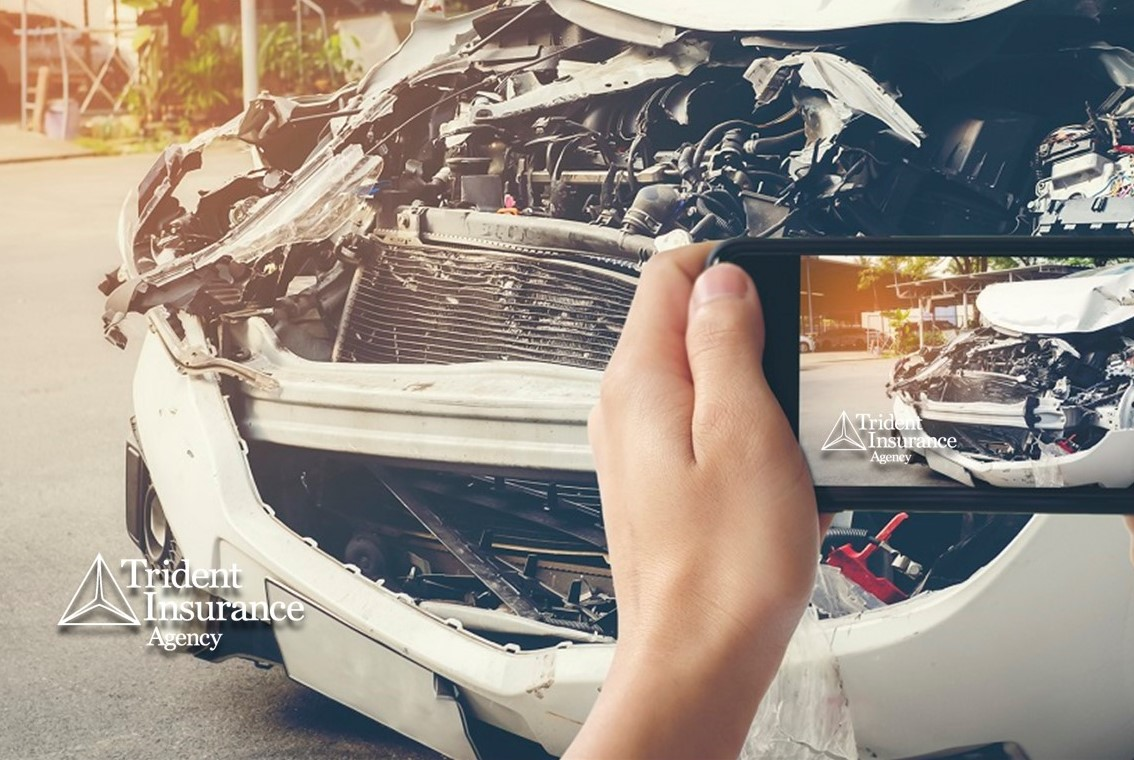 a person taking a photo of a car accident